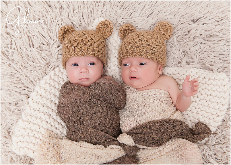 Blog 01 gilmore studios newborn shoot newport beach twins bear ears swaddled hand brown neutral eyes fur brothers